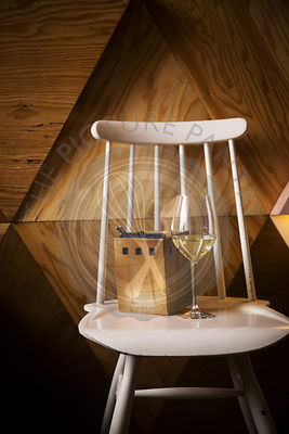 Glass of white wine standing on a vintage chair
