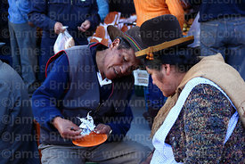 Shaman or yatiri reading future from shapes formed by molten tin that has been dropped in cold water, La Paz, Bolivia