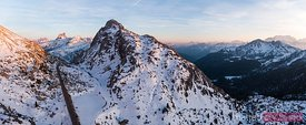 Aerial pano sunset over Dolomites mountain pass, Italy