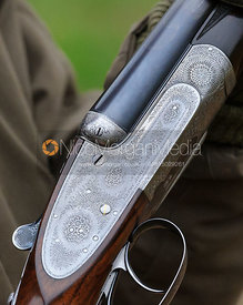 Game shooting images - close up of side by side shotgun