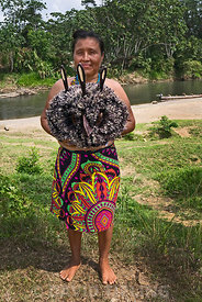 Emberå Indian lady from Nuevo Vigia on the Rio Tuquesa with a handmade mask of the Harpy Eagle in the Darién Panama