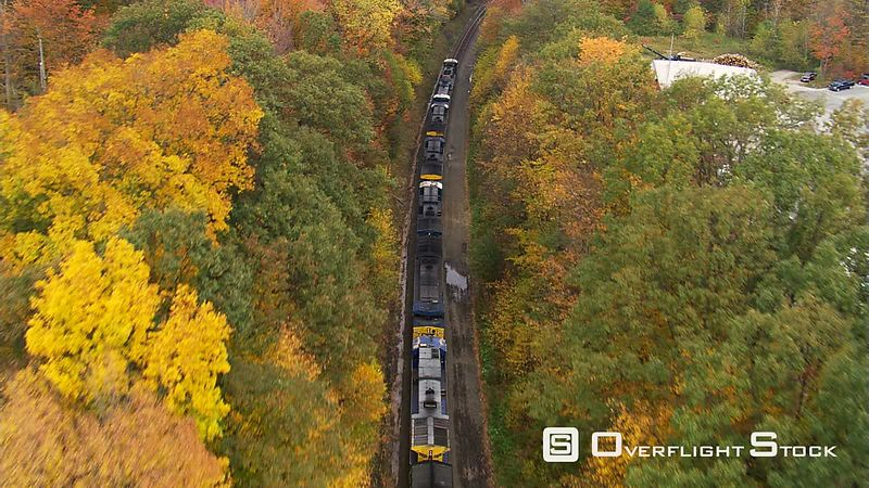 Low flight above train traveling through Massachusetts woods