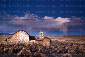 Rustic church near Lagunas and storm clouds at twilight, Sajama National Park, Bolivia