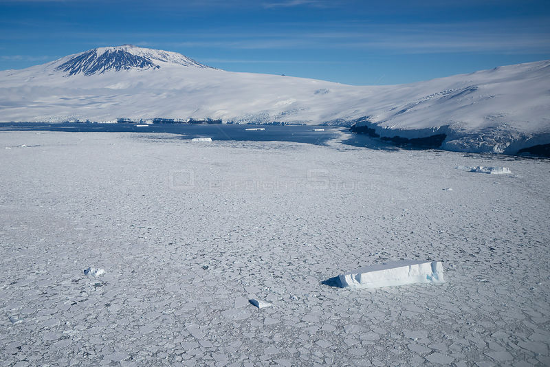 Sea ice and iceberg, Mount Erebus, Ross Island, Ross Sea, Antarctica.