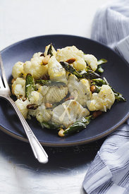 Cauliflower and asparagus salad on blue plate
