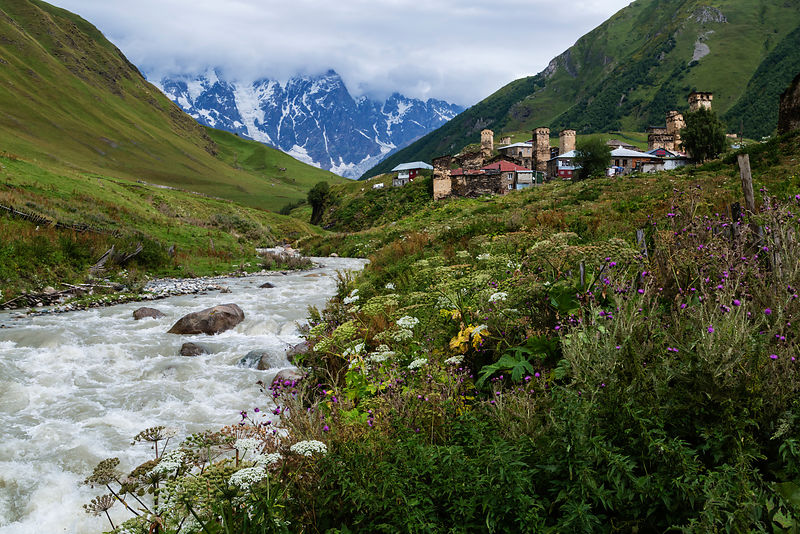 View of Ushguli from a Bridge over a Mountain Stream