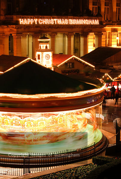 The German Market in Birmingham City Centre at Christmas. Carousel in front of The Council House in Victoria Square.