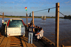 Car on raft crossing the River Mamoré between San Ignacio de Moxos and Trinidad , Beni , Bolivia