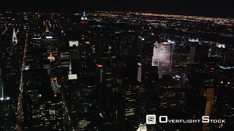 Night flight over Manhattan toward Empire State Building.
