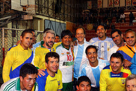 Bolivian president Evo Morales poses with members of the Argentine and Venezuelan embassy teams at a futsal tournament, La Paz, Bolivia