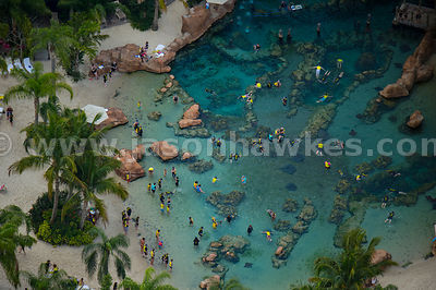 Owned by SeaWorld, Discovery Cove is a park where guests can swim with dolphins and interact with other marine animals including tropical fish and rays.