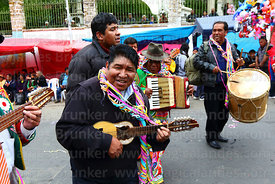 Man playing a charango during parades for the Entierro del Pepino, La Paz, Bolivia