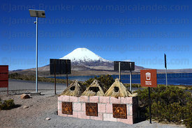 Solar powered street light and recycling bins outside CONAF wardens hut at Lake Chungara , Parinacota volcano in background , Lauca National Park , Region XV , Chile