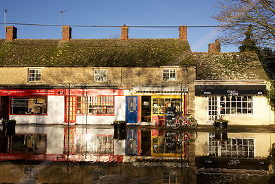 Colourful Shop Fronts Reflected in Flood Waters in Kidlington Oxfordshire