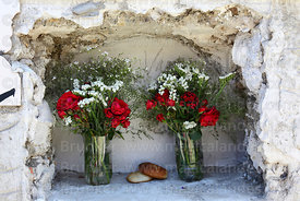Rustic tomb with bread roll offerings and flowers for Todos Santos festival, La Paz, Bolivia
