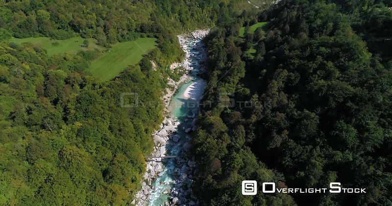 Mountain rapids, C4K aerial tilt drone view of a turquoise soca river, revealing the nature, near Trigolov national park, on a sunny summer day, in the Julian alps, Slovenia