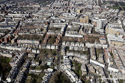 aerial photograph of Kensingtonl London   England UK. In the image can be seen Collingham Gardens, London SW5 0HW,Bramham Gardens.Kensington, London SW5 0JQ,Bousfield Primary School, London SW5 0DJ and  Old Brompton Rd, London SW5 0BS