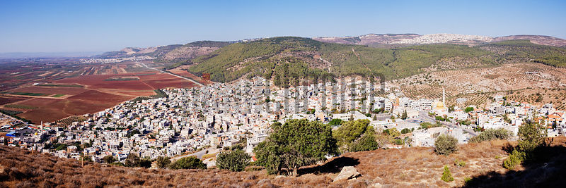 Panoramic view of Daburiyya Arab Village at the foot of Mount Tabor in the Lower Galilee,  and Jezreel Valley