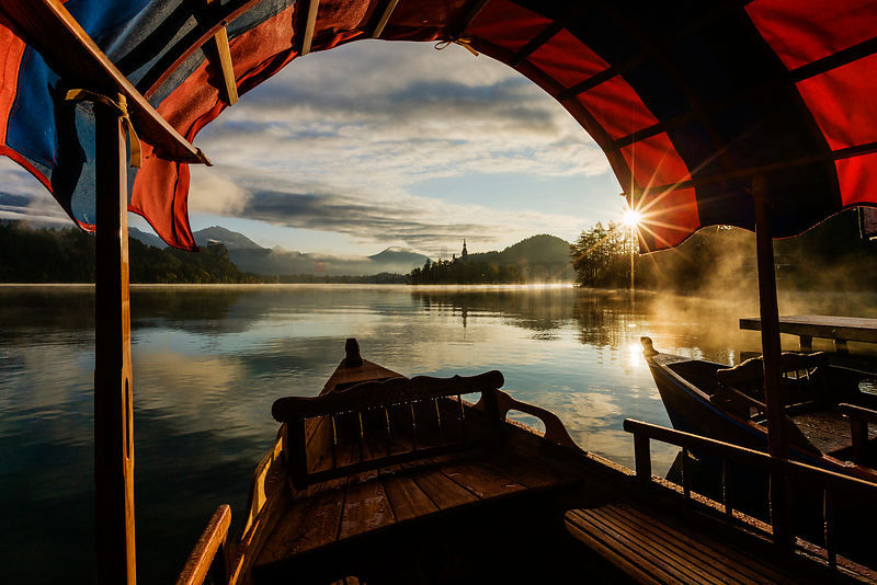Tour Boats Moored on Lake Bled at Sunrise