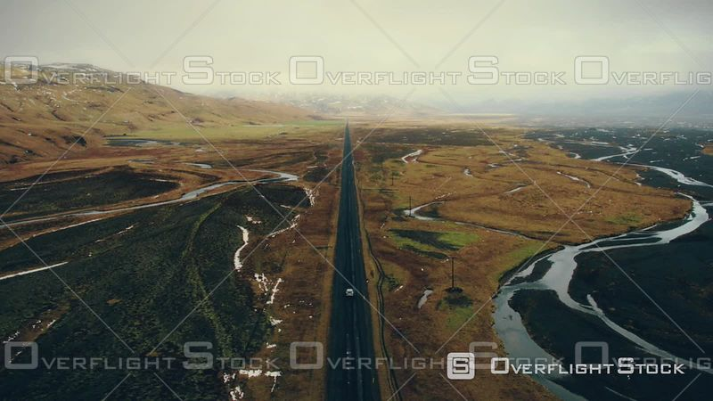 Aerial View of a Car on an Endless Road Driving Inside Porsmork National Park, Filmed by Drone, Iceland