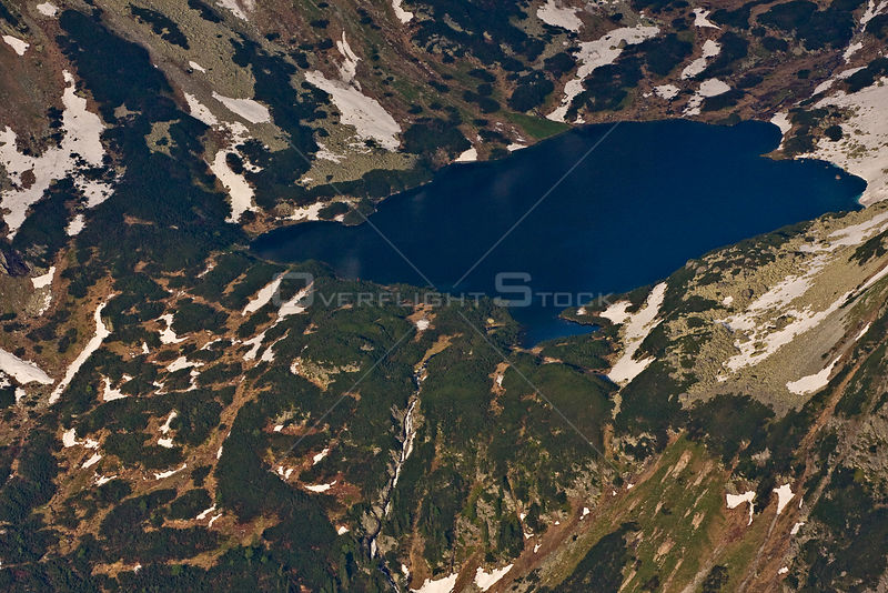 Aerial view of the Temnosmrecianske lake and waterfall at sunset, High Tatras, Carpathian Mountains, Slovakia, June 2009