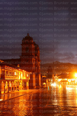 Compañia de Jesus church and Plaza de Armas at night in rainy season, Cusco, Peru