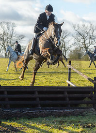 Paul Chenery jumping a fence at Cream Gorse - The Quorn at Cream Gorse Farm