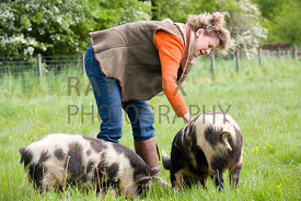 Anna Dalrymple with Kunekune pigs (native to New Zealand)