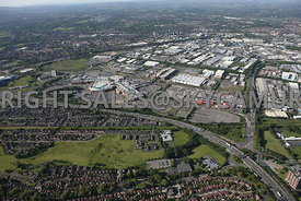 Manchester aerial photograph of Trafford Park and the Intu Trafford Centre looking from across the M 60 motorway and Junction 9 showing the road links into the Trafford Park Estate