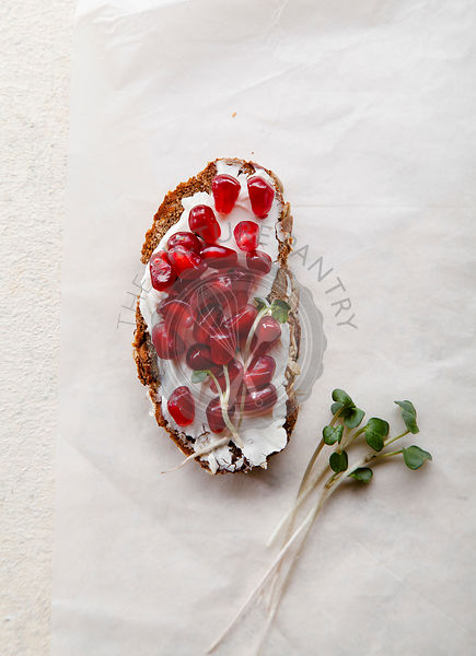 Bruschetta with pomegranate seeds and cream cheese