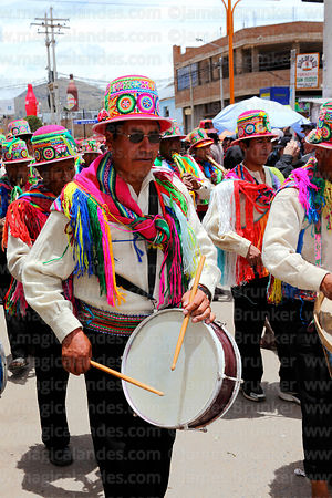 Musician from Lampa village wearing traditional dress , Virgen de la Candelaria festival, Puno, Peru