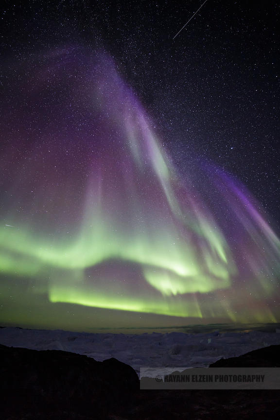Green and purple Aurora above the icebergs in Ilulissat, Greenland