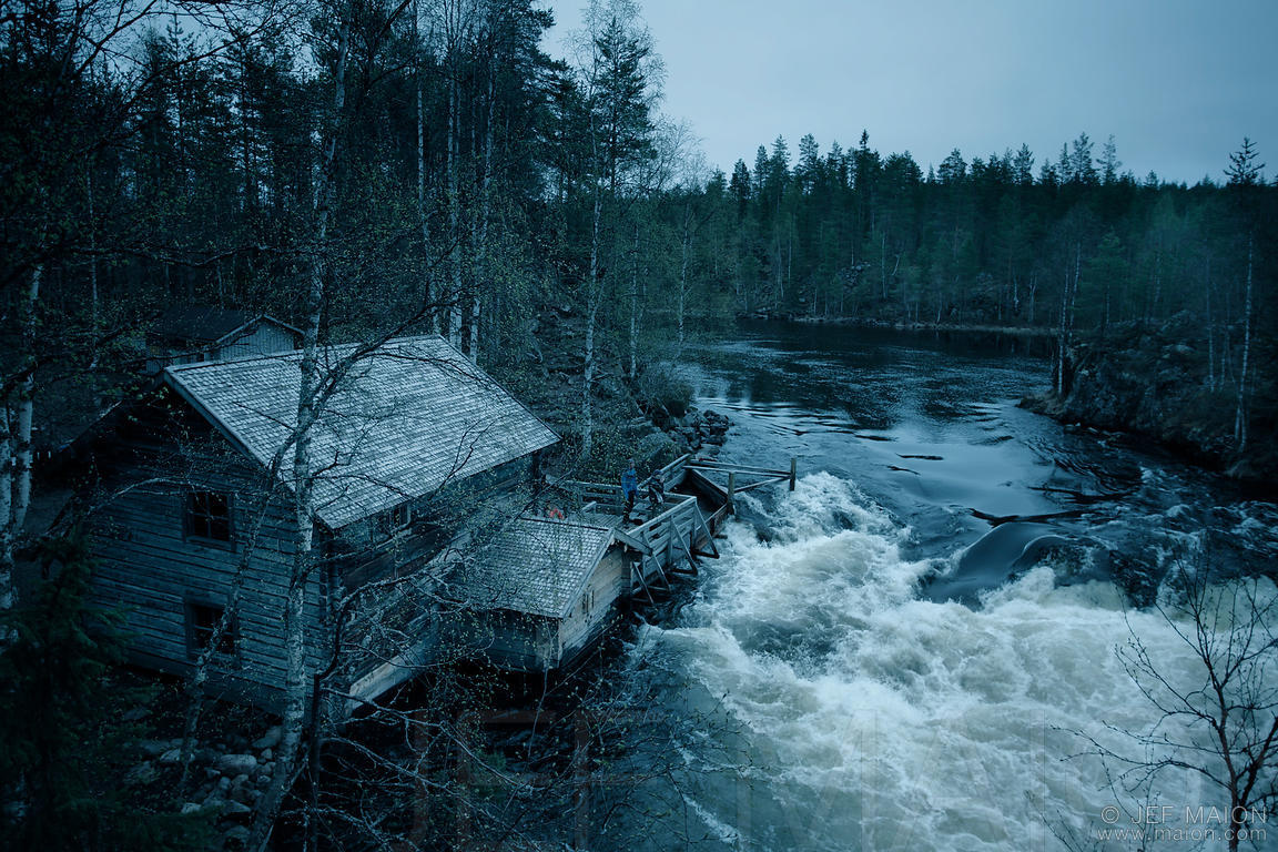 Old log house by river