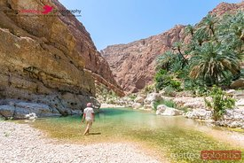 Oman, Wadi Shab. Tourist at oasis inside the canyon