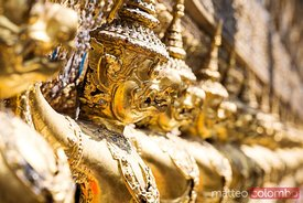 Detail of carved golden statues on temple, Bangkok, Thailand