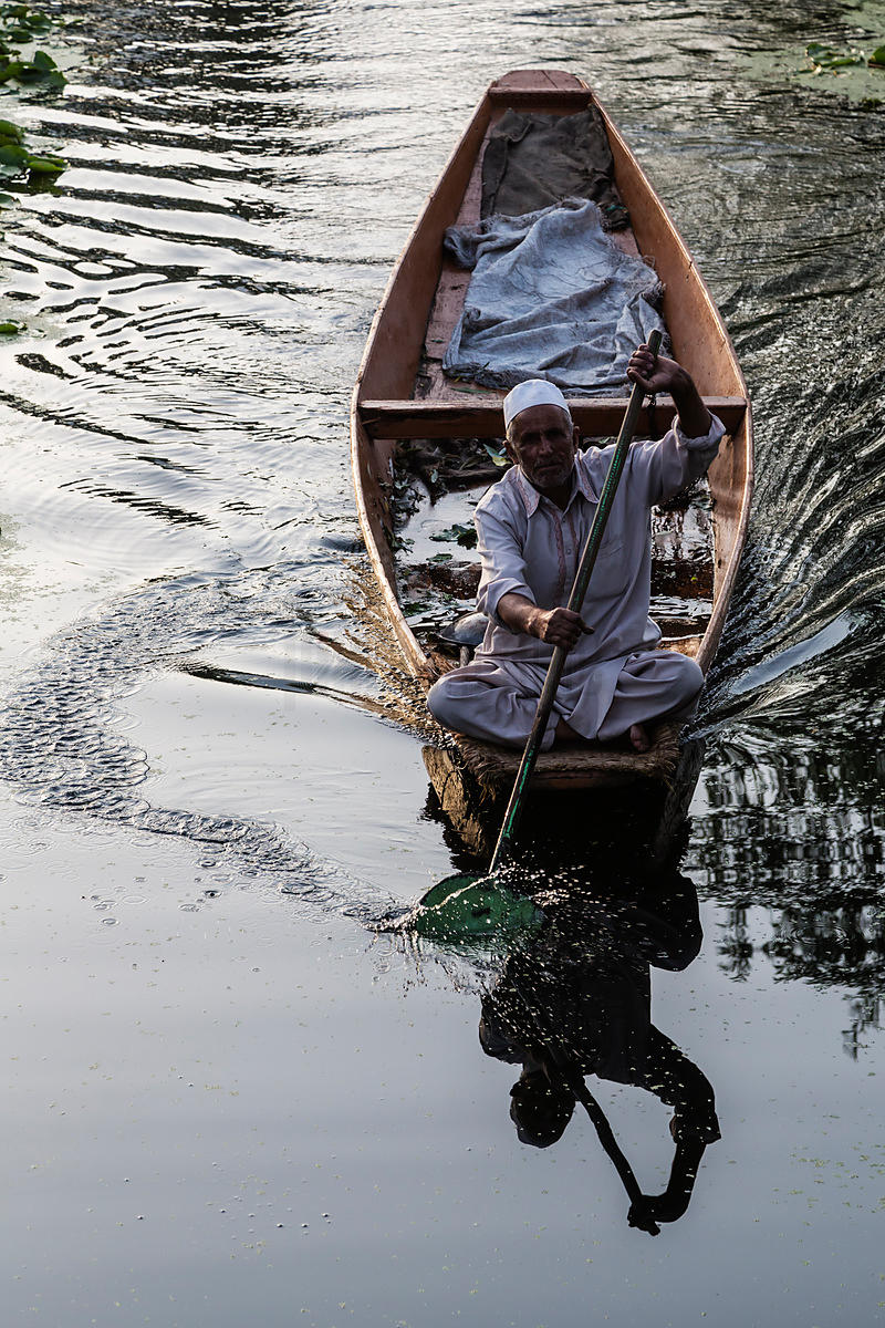 Man Paddling his Shikara from the Floating Market