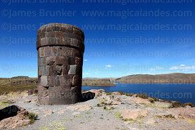 Cut stone Inca period chulpa / burial tower and Lake Umayo, Sillustani, Peru