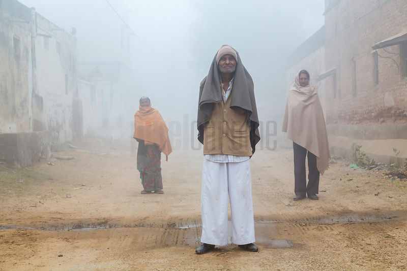 Men Standing in a Road on a Foggy Morning