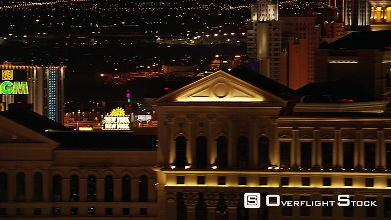 Flying over casino rooftops in Las Vegas at night.