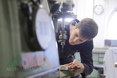 Germany, Young mechanic working in crafts workshop
