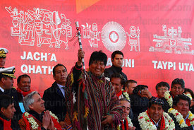 Bolivian president Evo Morales holds a traditional baton of command during the inauguration ceremony of the Red Line cable car, La Paz, Bolivia