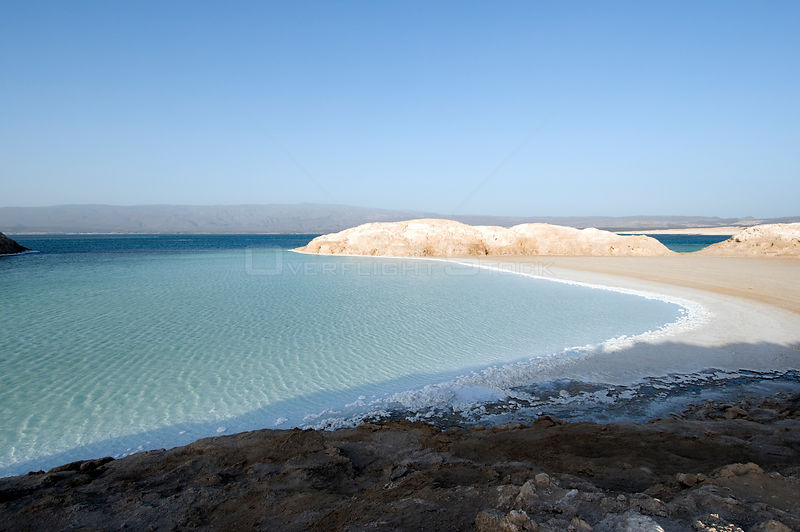 Lake Assal -  Africas lowest point at 515 feet below sea level , with dense concentrations of salt on the shoreline - Djiboutim , March 2008