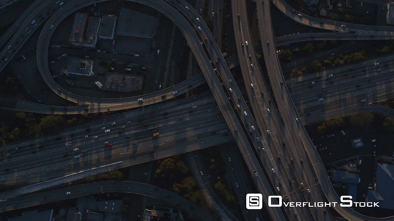 Looking down at a cloverleaf of highway interchanges in Los Angeles. Shot in October