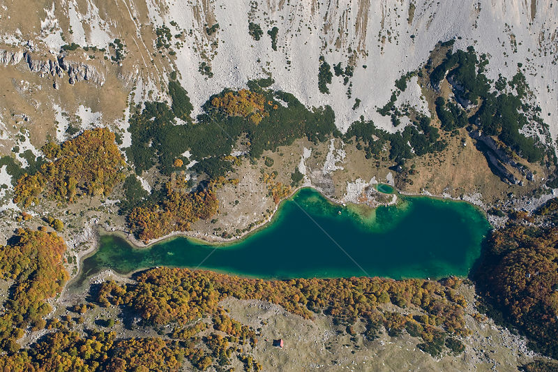 Aerial view of Skrcko Lake with a Katun (shepherd's summer hut) Durmitor NP, Montenegro, October 2008