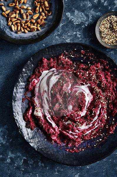 Dark and moody Beetroot dip with yogurt, toasted pinenuts.