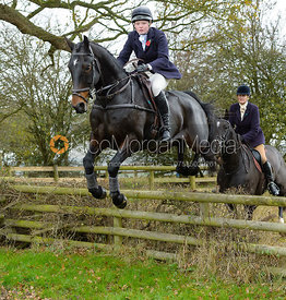 Meghan Healy jumping a fence on Leicester Lane  - The Cottesmore at The Fox and Hounds