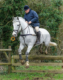 Charlie Gordon-Watson jumping a hunt jump near Knossington Spinney