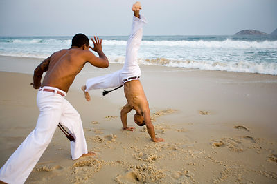 Brazil - Rio - Capoeiristas practicing Capoeira on Leblon Beach