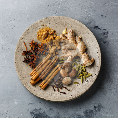 Spice Ingredient - .allspice, anise star, cardamon, cinnamon stick, ginger root, nutmeg - for Mulled wine hot drink on concrete background