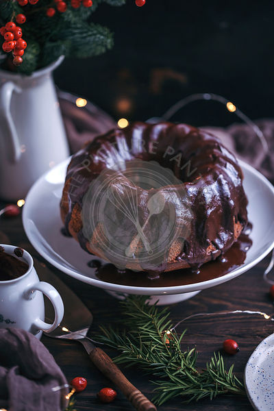 Chocolate bundt cake with chocolate ganache on a cake stand